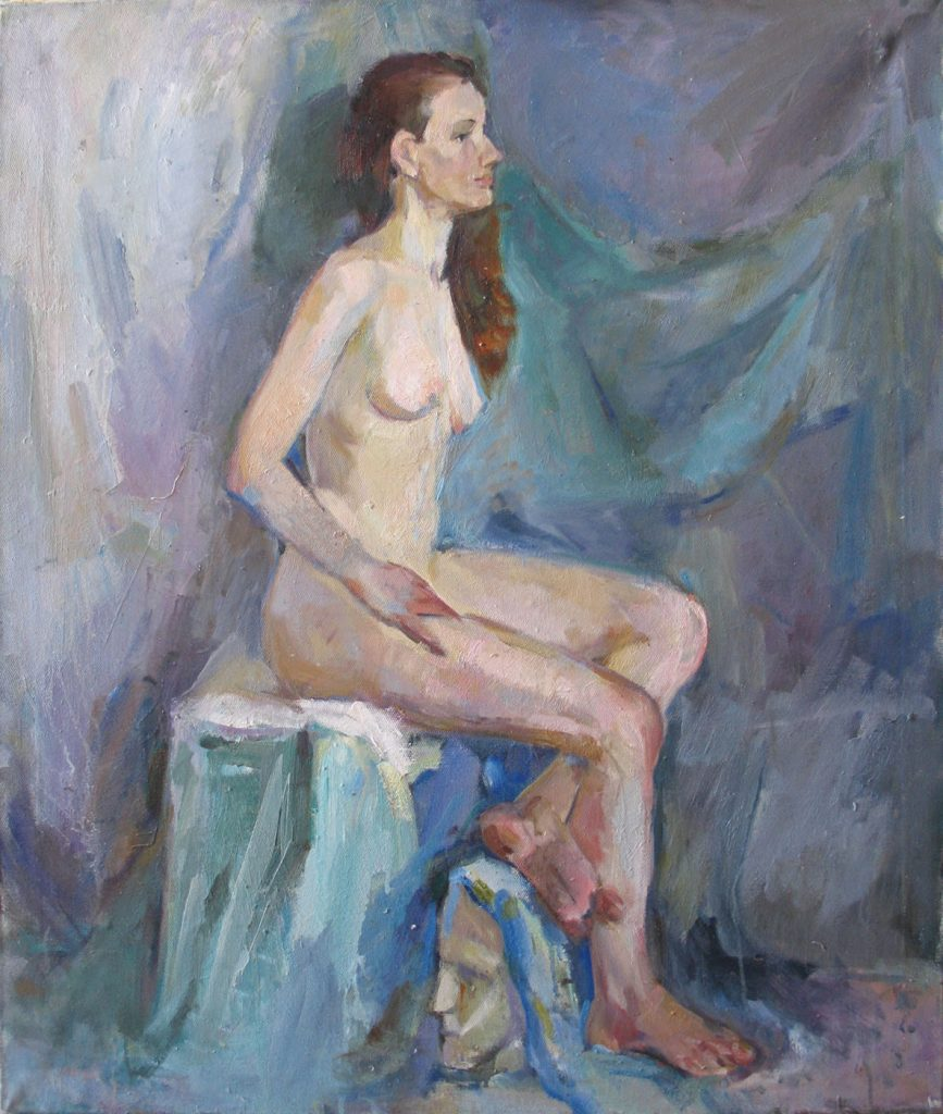 Nude on a background of green drapery